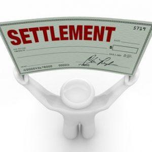 Man holding a settlement check