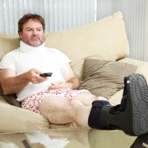 Depressed man sitting on couch after workers' compensation injury